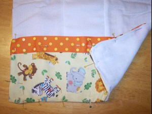 Pin the fabric and ribbon in place